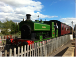 Steam train coming into the station